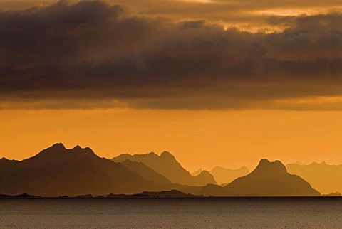 The silhouette of the Lofoten Wall, the mountains of the Lofoten islands, as seen from near Reine, island of Moskenesoy, Moskenesoy, Lofoten archipelago, Nordland, Norway, Europe