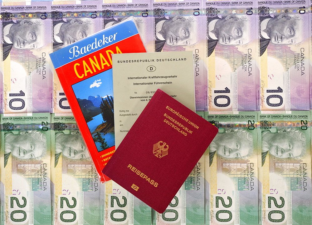 International driving license, passport of the Federal Republic of Germany, guide book for Canada, various Canadian dollar banknotes