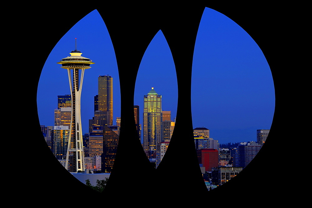 "View through steel sculpture ""Changing Form"" by Doris Chase, Kerry Park, of the skyline of the Seattle financial district with Space Needle, full moon, Columbia Center, formerly Bank of America Tower, Municipal Tower, formerly Key Tower, US Bank Center, n"