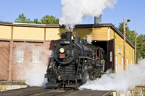 Old steam locomotive, 7470 model, driving out of the heating house, Conway Scenic Railroad in Conway, New Hampshire, USA