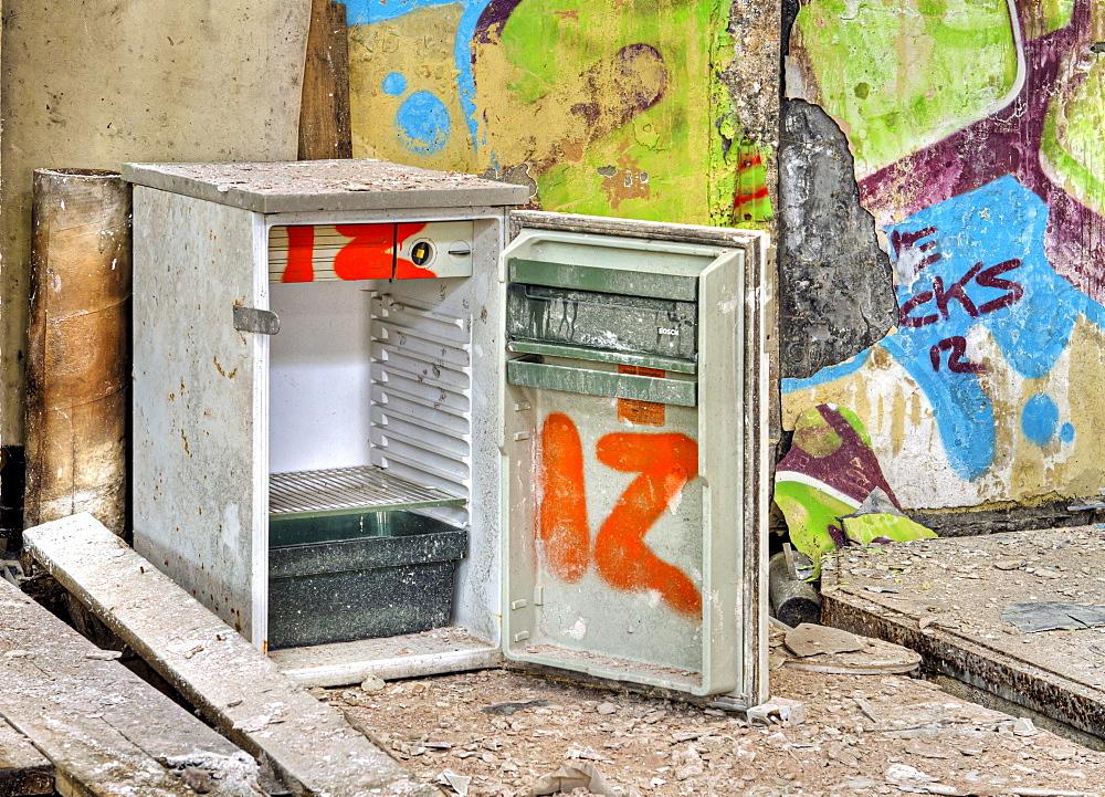 Refrigerator, graffiti, abandoned factory