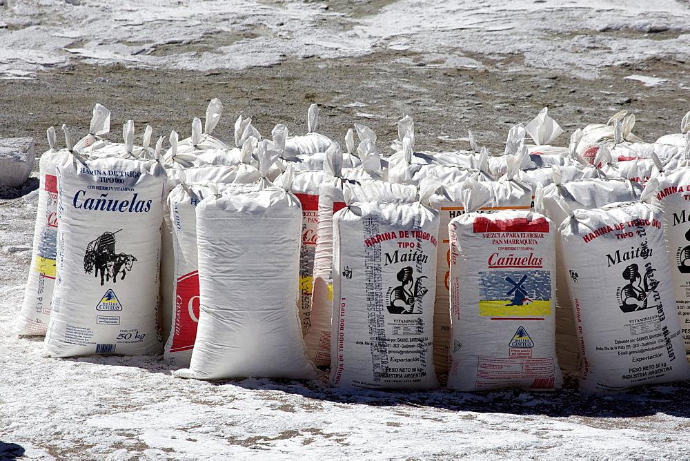 Salt, packed in flour bags, at a salt lake, Atacama Desert, Altiplano, southern Bolivia, South America