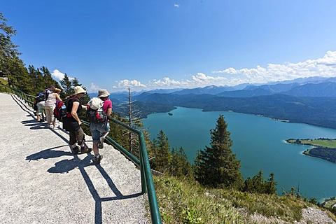 Hikers taking in the views from Mt Herzogstand across Walchensee Lake, district of Bad Toelz-Wolfratshausen, Upper Bavaria, Bavaria, Germany, Europe, PublicGround