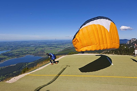 Hang glider taking off, Mt Tegelberg, Froggensee Lake at back, Upper Bavaria, Bavaria, Germany, Europe, PublicGround