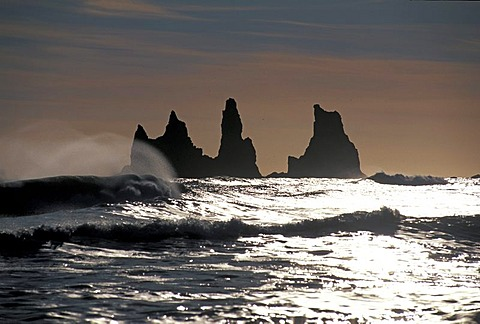Reynisdrangar group of rocks near Vik i M˝rdal with Skessudrangur, Laddrangur and Langhamar rock formations, according to legend, three petrified trolls, south coast, Iceland, Europe