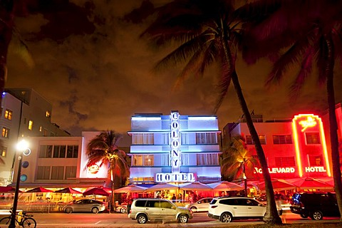 Illuminated Art Deco hotels along famous Ocean Drive in South Beach, Miami Beach, Florida, USA