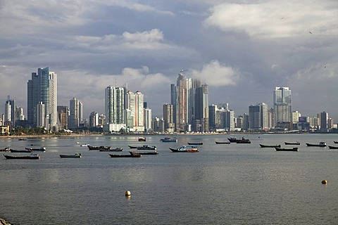 Fishing boats against the skyline of Panama City, Panama, Central America