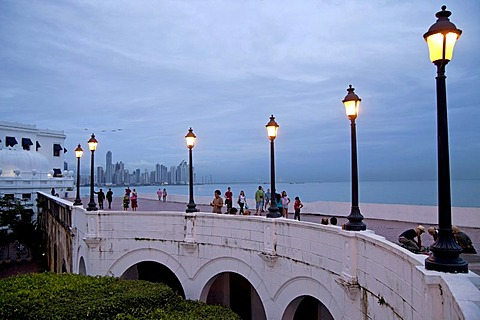 Lanterns along the promenade, Paseo Esteban Huertas, in front of the skyline of Panama City at dusk, Panama, Central America
