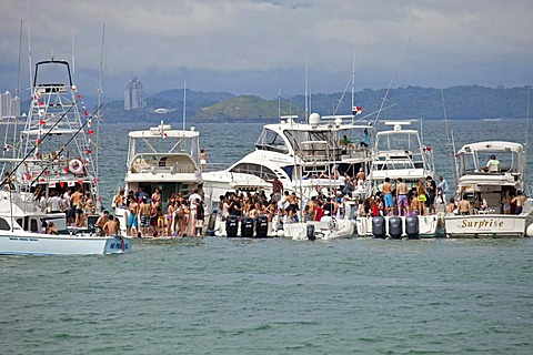 Young people from Panama City celebrating a weekend party on yachts on the island of Isla Taboga, Panama, Central America