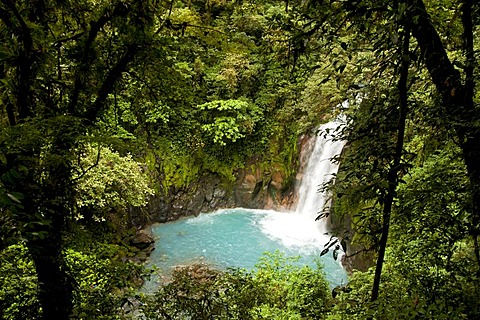 Waterfall with the blue waters of the Rio Celeste in Volcan Tenorio National Park, Costa Rica, Central America