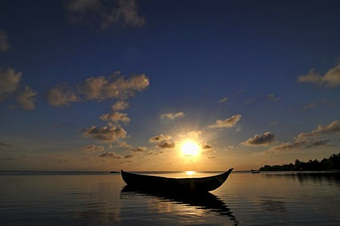 Traditional Malagasy boat near the beach at sunset, Madagascar, Africa