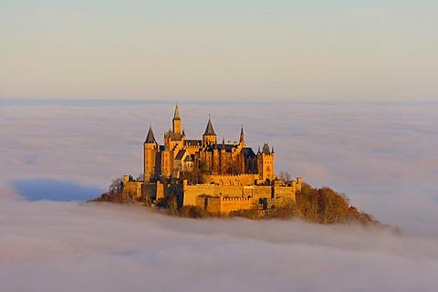 Burg Hohenzollern castle in morning light, early morning fog, Swabian Alb, Baden-Wuerttemberg, Germany, Europe