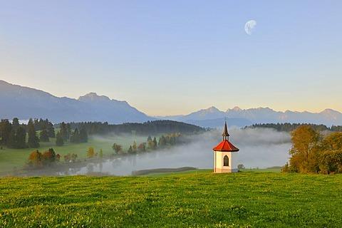 Chapel at Hegratsrieder See, lake, with moon, digital composing, near Fuessen, Allgaeu, Bavaria, Germany, Europe