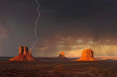 Lightning strikes during a thunderstorm in the evening light, composite, mesas with West Mitten Butte, East Mitten Butte, Merrick Butte, Monument Valley, Navajo Tribal Park, Navajo Nation Reservation, Arizona, Utah, United States of America, USA