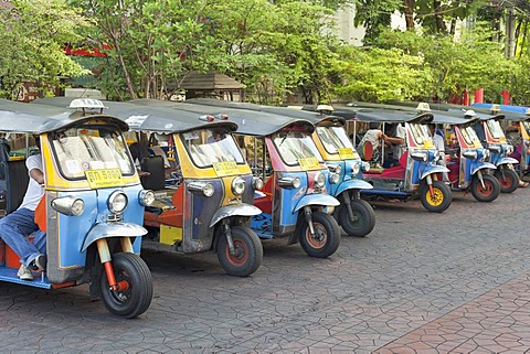 Line-up of auto rickshaws or tuk-tuks in Soi Rambutri, Bangkok, Thailand, Asia