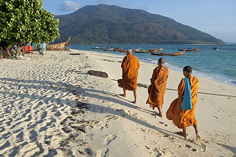 Monks collecting morning alms on the beach, island of Ko Lipe, Thailand, Asia