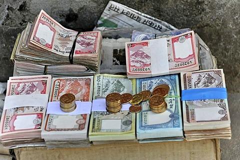 Banknotes on a street vendor's stall, Kathmandu, Kathmandu Valley, Nepal, Asia