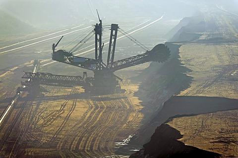 Bucket-wheel excavator in the mist, Tagebau Garzweiler open pit mine, Grevenbroich, North Rhine-Westphalia, Germany, Europe