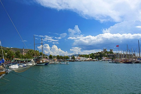 Gulet boats in the marina and St. Peter's castle in Bodrum, Turkish Aegean Coast, Turkey