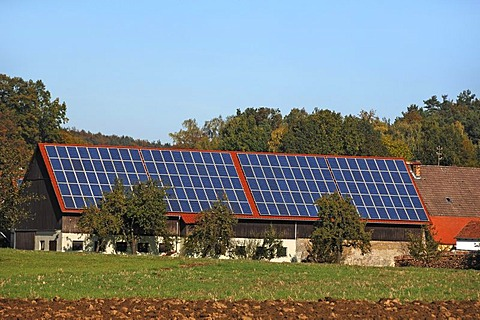 Photovoltaic system on the roof of farm buildings, Morschreuth, Upper Franconia, Bavaria, Germany, Europe