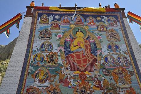 Tibetan Buddhism, religious fabric, large Thangka of Sera, a giant Buddha image is unfurled during the Shoton, Sho Dun or Yoghurt Festival, Sera Monastery, Lhasa, Tibet, China, Asia