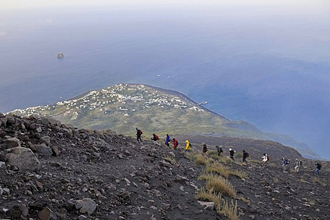Tourist group hiking to the crater of Mt Stromboli, volcanic island of Stromboli, Aeolian Islands or Lipari Islands, Sicily, Southern Italy, Italy, Europe