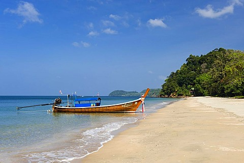 Long-tail boat on the sandy beach, Ao Si Beach, Ko Jum or Koh Pu island, Krabi, Thailand, Southeast Asia