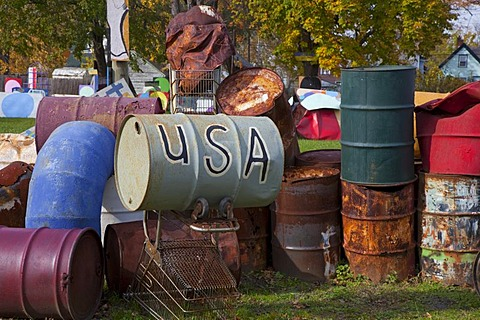 "Old barrels, on of them labelled ""USA"", artwork at the Heidelberg Project, an outdoor public art project in a depressed neighborhood of Detroit created by artist Tyree Guyton, Michigan, USA"