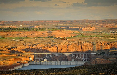 View from Wahweap View Overlook at Glen Canyon Dam in the evening light, behind Glen Canyon Bridge with Highway 89, Page, Glen Canyon National Recreation Area, Arizona, United States of America, PublicGround