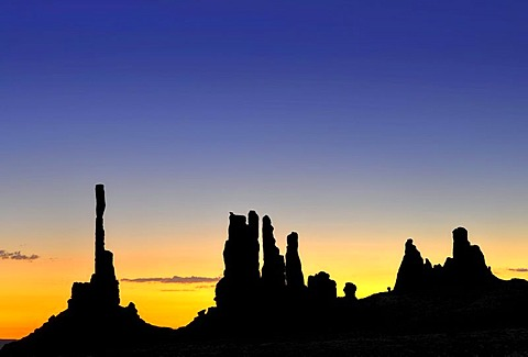 Totem Pole and Yei Bi Chei rock formations, silhouetted before sunrise, dawn, Monument Valley, Navajo Tribal Park, Navajo National Reservation, Arizona, Utah, USA