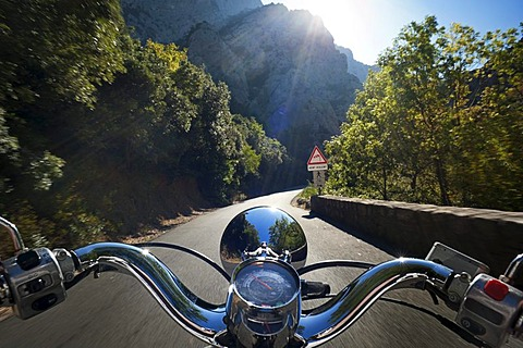 Motor scooter being driven in the Gorges de Galamus, a narrow passage between the departments Aude and Pyrenees-Orientales, Northern Catalonia, France, Europe, PublicGround