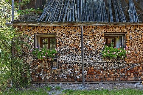 A wood pile and hay drying racks, Bauernhausmuseum Amerang farmhouse museum, Amerang, Bavaria, Germany, Europe