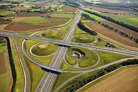 Aerial view, ADAC monument to honour the Yellow Angels, artist Alex Gockel, at the Kamener Kreuz, cross junction of the A1 and A2 motorways, Kamen, Ruhr Area, North Rhine-Westphalia, Germany, Europe