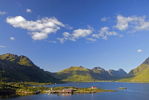The tiny village of Sildpollnes and its church, surrounded by water and high mountains on the Lofoten island of AustvÂgoy, Nordland, Norway, Europe