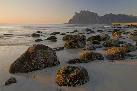 Boulders at Uttakleiv Beach illuminated by warm evening light, Nordland, Norway, Europe