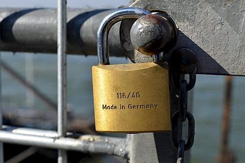 Padlock, Made in Germany, at a barrier fence along the Rhine Promenade, Duesseldorf, North Rhine-Westphalia, Germany, Europe