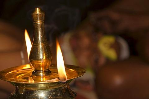 Oil lamp burning during the spiritual ceremony of applying the make-up of the Kathakali dancers, Varkala, Kerala, India, Asia