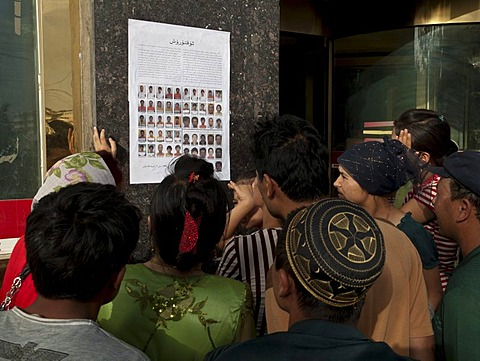 Uigurs looking for their missed family members after the riots in Kashgar in July 2009, Xinjiang, China, Asia