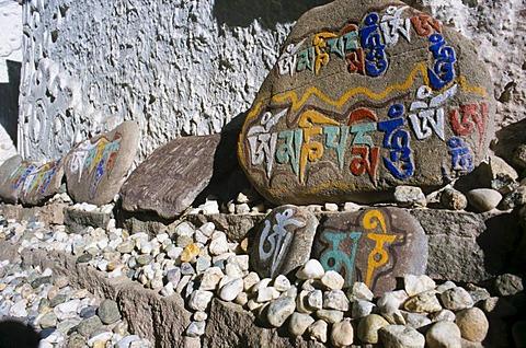 Mani stones with the Buddhist mantra of Avalokiteshvara, the Om Mani Padme Hum, Leh, Jammu and Kashmir, India, Asia