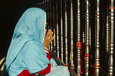 Woman praying at a temple in the holy place Baba Ram Dev, Jaisalmer, Rajasthan, India, Asia