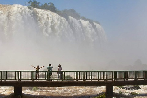 Tourists on a footbridge in front of the Iguazu or Iguacu falls, Brazilian side, Unesco National Park, Misiones Province, Argentina, South America