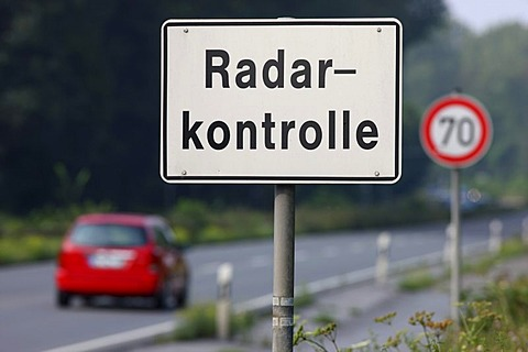 Official sign to warn of a radar control with a TraffiTower speed camera, on the federal road B224, Braukstrasse, in a 70 kilometers per hour speed-limit zone, Bottrop, North Rhine-Westphalia, Germany, Europe