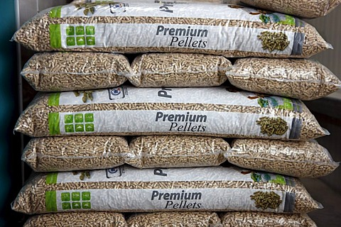 Wood pellets for heating packaged in sacks, at the WestPellets company in Titz, North Rhine-Westphalia, Germany, Europe