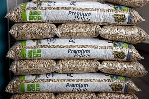 Wood pellets for heating packaged in sacks, at the WestPellets company in Titz, North Rhine-Westphalia, Germany, Europe