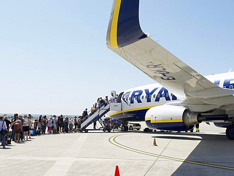 Ryanair passengers in a queue at the airfield waiting to board an airplane, Frankfurt-Hahn Airport, Rhineland-Palatinate, Germany, Europe