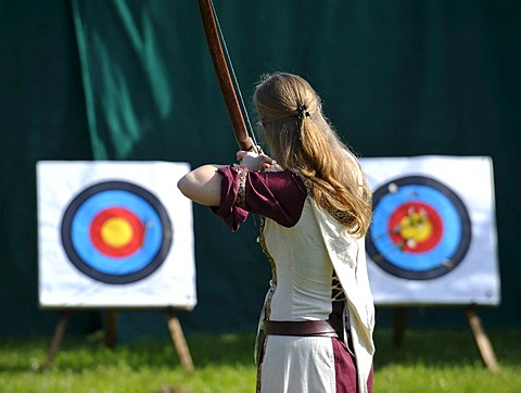 Woman wearing medieval clothes practising archery, Spectaculum, Maxlrain, Bavaria, Germany, Europe