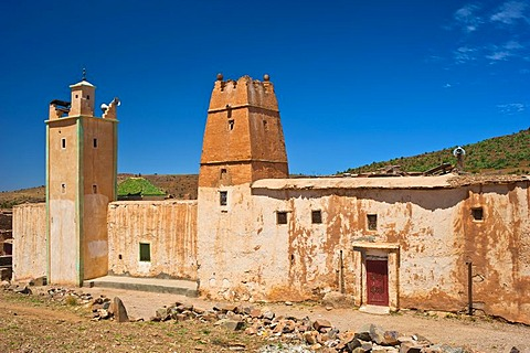 Islamic mosque with a minaret and part of a Kasbah, mud fortress, residential Berber castle, Tighremt, village of Ait Ourhaine, Anti-Atlas Mountains, southern Morocco, Morocco, Africa
