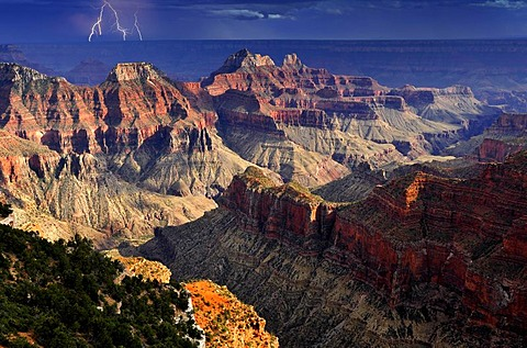 Thunderstorm with a lightning strike, view from Bright Angel Point towards Deva Temple, Brahma Temple, Zoroaster Temple, Transept Canyon, Bright Angel Canyon, sunset, evening mood, Grand Canyon National Park, North Rim, Arizona, United States of America,