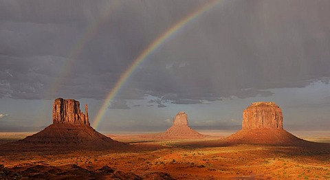 Double rainbow during a rain shower after a thunderstorm in the evening light, mesas, West Mitten Butte, East Mitten Butte, Merrick Butte, Monument Valley, Navajo Tribal Park, Navajo Nation Reservation, Arizona, Utah, United States of America, USA