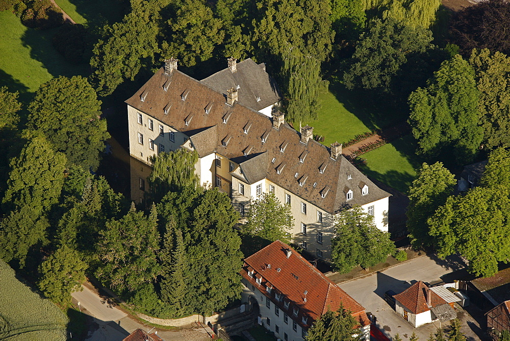 Aerial view, Schloss Wocklum castle, horse riding centre, Maerkischer Kreis region, Sauerland region, North Rhine-Westphalia, Germany, Europe